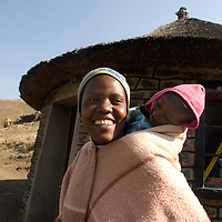Mapholaneng district, Lesotho<br /> Sefate village<br /> Makopang Tholo aged 22 with baby daughter Reitumetse aged nine months.