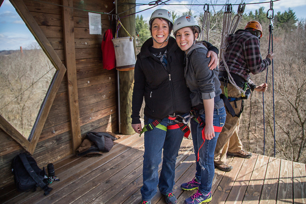 Barbara Havens and her daughter Sarah Scarberry pose for a photo after reaching the top of the tower at Outdoor Pursuit's Challenge Course at the Ridges before ziplining back down on Saturday afternoon, April 5, 2014. Photo by Katelyn Vancouver / Ohio University