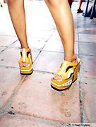Girl wearing a pair of yellow platform shoes Ibiza 1999