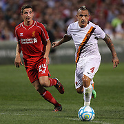 Radja Nainggolan, (right), AS Roma, is challenged by Joe Allen, Liverpool, in action during the Liverpool Vs AS Roma friendly pre season football match at Fenway Park, Boston. USA. 23rd July 2014. Photo Tim Clayton