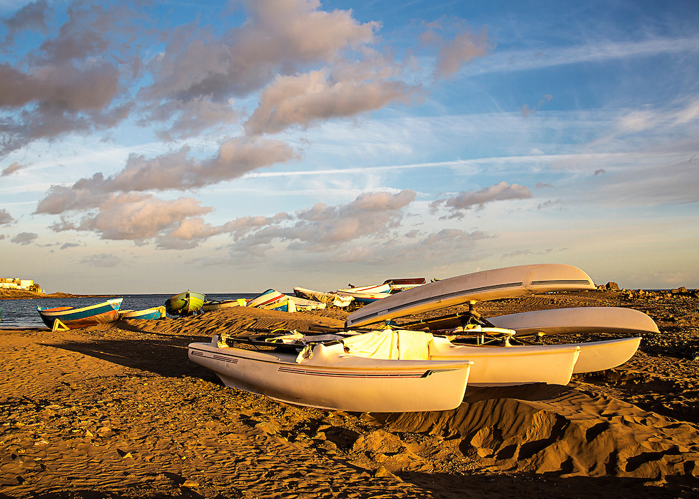 Boats On A Beach At Sunset