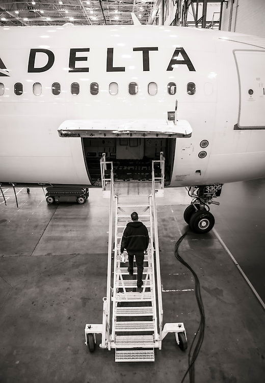 A technician mounts the stairs while conducting a maintenance check at Delta Tech Ops, Atlanta.  Created by aviation photographer John Slemp of Aerographs Aviation Photography. Clients include Goodyear Aviation Tires, Phillips 66 Aviation Fuels, Smithsonian Air & Space magazine, and The Lindbergh Foundation.  Specialising in high end commercial aviation photography and the supply of aviation stock photography for commercial and marketing use.