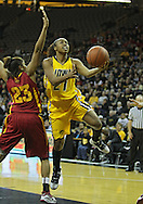 December 09 2010: Iowa guard Kachine Alexander (21) puts up a shot past Iowa St. guard Chassidy Cole (23) during the first half of their NCAA basketball game at Carver-Hawkeye Arena in Iowa City, Iowa on December 9, 2010. Iowa defeated Iowa State 62-40 in the Hy-Vee Cy-Hawk Series rivalry game.