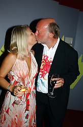CHRIS WRIGHT and his wife JANICE at the 60th birthday party for Chris Wright held at Sketch, Conduit Street, London W1 on 7th September 2004.