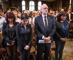 © Licensed to London News Pictures. 26/05/2017. London, UK. Labour party leader Jeremy Corbyn stands for a minute's silence with (L-R) his wife Laura Alvarez and Labour Party shadow cabinet members Shami Chakrabarti and Diane Abbott to remember the victims of the Manchester bombing - before making an election speech. All election campaigning was stopped as a mark of respect for the victims of Monday's terror attack in Manchester in which 22 people died. Photo credit: Peter Macdiarmid/LNP