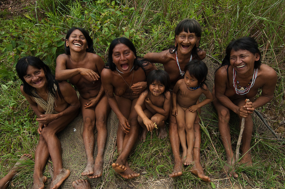 Huaorani sitting in the forest.<br /> Bameno Community. Yasuni National Park.<br /> Amazon rainforest, ECUADOR.  South America<br /> This Indian tribe were basically uncontacted until 1956 when missionaries from the Summer Institute of Linguistics made contact with them. However there are still some groups from the tribe that remain uncontacted.  They are known as the Tagaeri &amp; Taromenane. Traditionally these Indians were very hostile and killed many people who tried to enter into their territory. Their territory is in the Yasuni National Park which is now also being exploited for oil.
