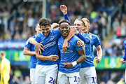 Portsmouth Midfielder, Jamal Lowe (10) and Portsmouth Midfielder, Gareth Evans (26) celebrate after Portsmouth Midfielder, Jamal Lowe (10) scores a goal to make it 3-0 during the EFL Sky Bet League 1 match between Portsmouth and Oxford United at Fratton Park, Portsmouth, England on 18 August 2018.