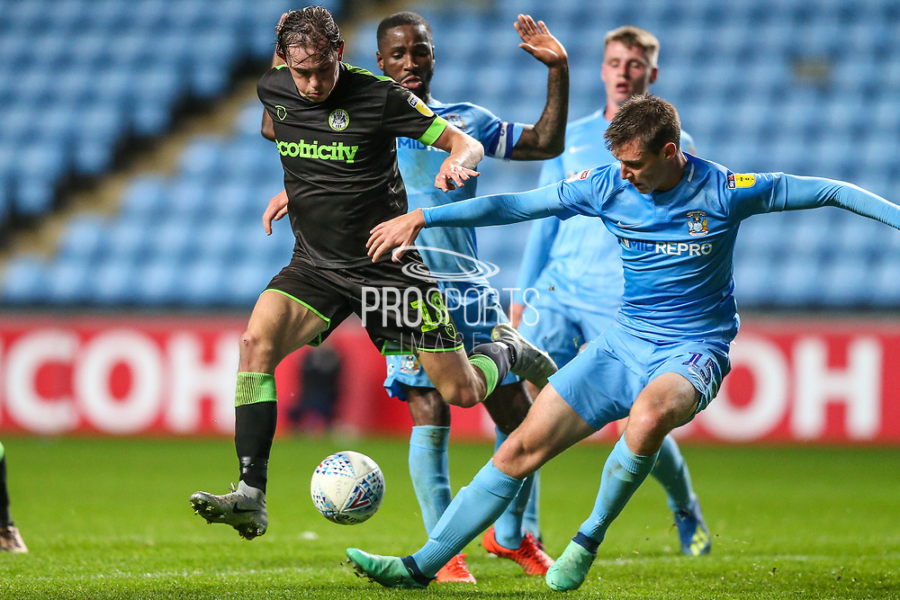 Forest Green Rovers Theo Archibald(18) battles with Coventry City defender Dominic Hyam (15)  during the EFL Trophy match between Coventry City and Forest Green Rovers at the Ricoh Arena, Coventry, England on 9 October 2018.