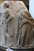 Sculpted marble column drum. Circa 325-300 BC. Found in Ephesus at the temple of Artemis. This view shows a youthful winged Thanatos (death), a draped woman (possibly Alcestis or Eurydice).