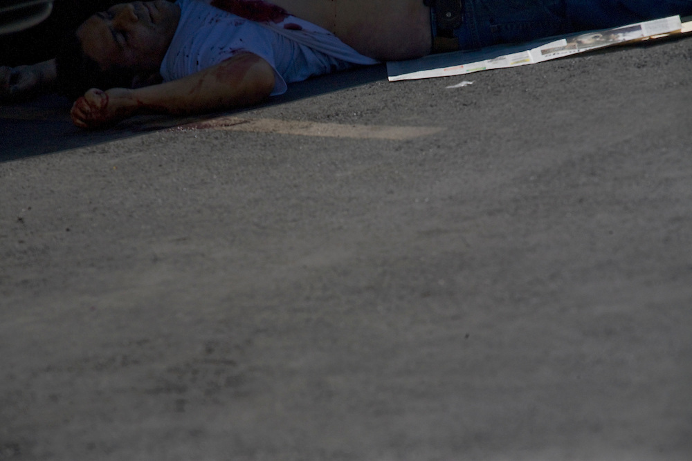A man shot to death in a parking lot of a large shopping center in Ciudad Juarez, Chihuahua on May 13, 2010.