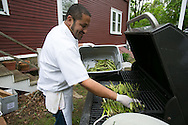 Cohasset, MA 05/11/2013.Chef Robin King grills asparagus harvested from the farm's own fields during Holly Hill Farm's farm to table dinner on Saturday evening..Alex Jones / www.alexjonesphoto.com