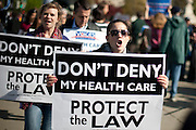 Protesters from both sides campaigned outside of the U.S. Supreme Court in Washington, D.C. on Monday as the court began three days of oral arguments over the constitutionality of the health care law championed by President Barack Obama. The majority of justices appearing to reject suggestions they wait another few years before deciding the issues.
