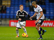 Ryan Woods of Brentford and Darren Pratley of Bolton Wanderers during the Sky Bet Championship match between Bolton Wanderers and Brentford at the Macron Stadium, Bolton<br /> Picture by Mark D Fuller/Focus Images Ltd +44 7774 216216<br /> 30/11/2015