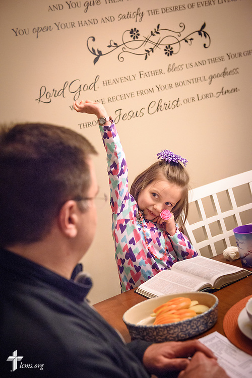Elizabeth Vogt responds to a question from her father Michael as the family holds an evening devotion with the Congregation at Prayer resource at their home on Sunday, Feb. 7, 2016, in Menomonee Falls, Wis. LCMS Communications/Erik M. Lunsford