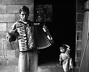 A teenage boy from the Music for Hope project taking part in a music lesson led by UK based tutor Katherine Rogers.<br /> Community of La Canoa,<br /> Bajo Lempa, El Salvador.1999