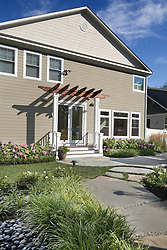 VA1-966-326 322 Owaissa home rear entrance with pergola and large stone pathway