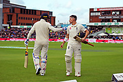 Wicket - Rory Burns of Englandlooks dejected as he walks back to the pavilion after being dismissed by Josh Hazlewood of Australia and meets meets Jason Roy of England as he comes out to bat during the International Test Match 2019, fourth test, day three match between England and Australia at Old Trafford, Manchester, England on 6 September 2019.