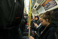 Morning rush to work, Tube, London.