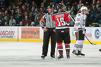KELOWNA, CANADA - NOVEMBER 9:  Colton Sissons #15 of the Kelowna Rockets discusses a goal under review with the Brett Montsion, referee as the Red Deer Rebels visit the Kelowna Rockets on November 9, 2012 at Prospera Place in Kelowna, British Columbia, Canada (Photo by Marissa Baecker/Shoot the Breeze) *** Local Caption ***