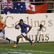 Alatasi Tupou dashes in for Manu Samoa's second try versus England.  Samoa prevailed 22-19 on the first day of action at the USA Sevens, Sam Boyd Stadium, Las Vegas, Nevada.  Photo by Barry Markowitz, Courtesy STP/TriMarine, 1/24/19, 4pm