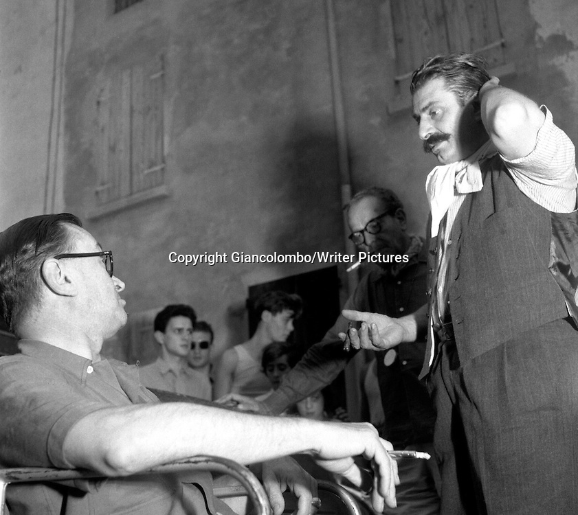 Giovannino Guareschi with director Julien Duvivier, on the set of the movie The Little World of Don Camillo, made out of his novel. Brescello, (Parma)<br /> 1951<br /> <br /> Photograph by Giancolombo/Writer Pictures<br /> <br /> WORLD RIGHTS, NO AGENCY, NO ITALY