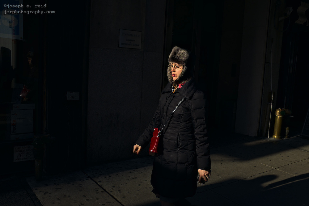 Woman in long parka and furry hat, New York, NY, US