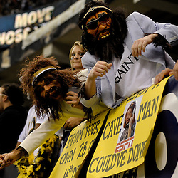 2009 November 30:  New Orleans Saints fans dressed as cavemen in the stands during a 38-17 win by the New Orleans Saints over the New England Patriots at the Louisiana Superdome in New Orleans, Louisiana.