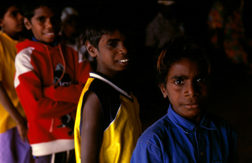 Kids outside the store R to L. Ambrose, Jayden and Gilbert. YIYILI, The Kimberley Western Australia