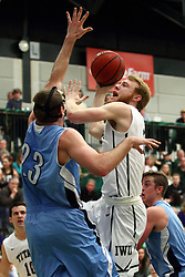 20 February 2016:  Colin Bonnett(11) takes a shot over Brandon Schwebke during an NCAA men's division 3 CCIW basketball game between the Elmhurst Bluejays and the Illinois Wesleyan Titans in Shirk Center, Bloomington IL