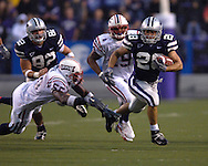 Kansas State running back John McCardle (28) rushes past Florida Atlantic linebacker Frantz Joseph (56) for a 28-yard gain in the first half, at Bill Snyder Family Stadium in Manhattan, Kansas, September 9, 2006.  The Wildcats beat the Owls 45-0.