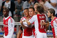 AMSTERDAM - 25-08-2012 - voetbal Eredivisie - Ajax - NAC, stadion Amsterdam Arena, 5-0, Ajax speler Niklas Moisander (3vl) wordt gefeliciteerd door Ajax speler Tobias Sana (2vl) en Ajax speler Daley Blind (2vr) na zijn doelpunt 2-0.