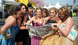 LIVERPOOL, ENGLAND - Friday, April 9, 2010: Race-goes check the form in the Racing Post on Ladies' Day during the second day of the Grand National Festival at Aintree Racecourse. (Pic by David Rawcliffe/Propaganda)