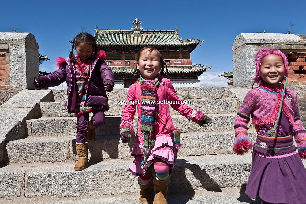 Mongolia. little girls playing in front of  Erdene Zuu temple   Hakhorin - Mongolia  Children fashion ,  Deux par Deux collection / petites filles jouant devant le temple de Erdene Zuu  Karakorum - Mongolie Mode enfant  / 17C