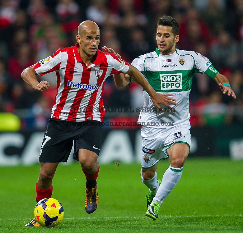 BILBAO, SPAIN - OCTOBER 31: Mikel Rico  (L) of&Ecirc;Athletic Club Bilbao&Ecirc;competes for the ball with Ferran Corominas  (R) of Elche FC during the La Liga match between&Ecirc;Athletic Club Bilbao&Ecirc;and&Ecirc;Elche FC&Ecirc;<br /> at&Ecirc;San Mames Stadium<br /> on October 31, 2013 in Bilbao, Spain.  (Photo by Juan Manuel Serrano Arce/Getty Images)