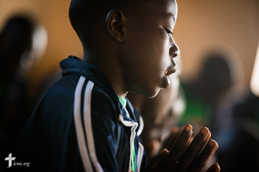 A young man in the Othoro ELCK (Evangelical Lutheran Church in Kenya) Project 24 program sings and prays during worship at the Othoro Lutheran congregation adjacent to the boarding facility on Sunday, Oct. 18, 2015, in Kisumu, Kenya. LCMS Communications/Erik M. Lunsford