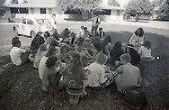 A group of popular kids hang out dressed like hippies during homecoming week activities during which time a home coming king and queen will be chosen in Porterville, California in the spring of 1989.
