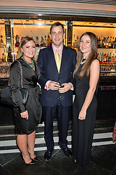 Left to right, JADE RICHARDS, ALEX HORSFALL and VICTORIA WEAVING at the Style for Soldiers dinner held at Le Caprice, 20 Arlington Street, London on 24th May 2016.
