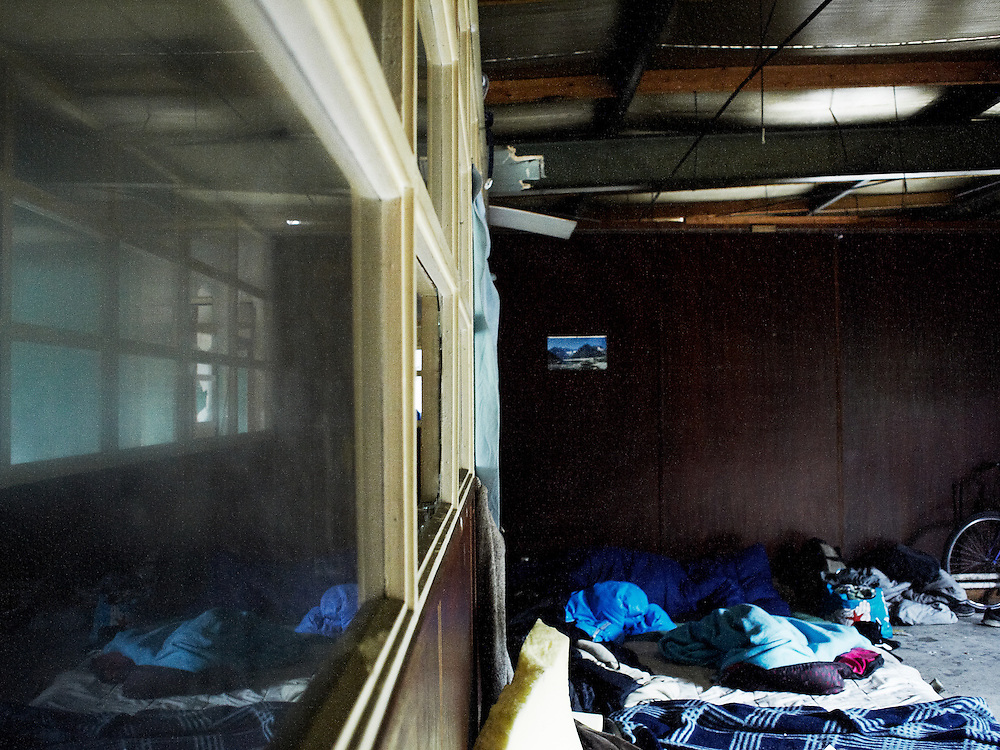 Beds inside a building where mostly African immigrants find shelter...Calais, the town that overlooks the Strait of Dover is considered by many illegal immigrants as the gate way to northern Europe. Despite the constant raids of the French police, the arrests and the hard measures against illegal immigration many still stay there. They find shelter in abandoned buildings where the living conditions are poor and difficult. Everyday they try to sneak in a boat in order to pass to UK.