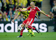 (R) Arjen Robben of Monachium fights for the ball with (L) Mats Hummels of Dortmund during the UEFA Champions League Final football match between Borussia Dortmund and Bayern Munich at Wembley Stadium in London on May 25, 2013...England, London, May 25, 2013..Picture also available in RAW (NEF) or TIFF format on special request...For editorial use only. Any commercial or promotional use requires permission...Photo by © Adam Nurkiewicz / Mediasport