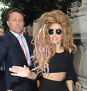 30.AUGUST.2013. LONDON<br /> <br /> LADY GAGA GREETS FANS OUTSIDE THE LANGHAM HOTEL IN LONDON<br /> <br /> BYLINE: EDBIMAGEARCHIVE.CO.UK<br /> <br /> *THIS IMAGE IS STRICTLY FOR UK NEWSPAPERS AND MAGAZINES ONLY*<br /> *FOR WORLD WIDE SALES AND WEB USE PLEASE CONTACT EDBIMAGEARCHIVE - 0208 954 5968*