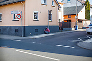 A man is repairing the wall of his house close to the main road in Stierstadt which belongs to the city of Oberursel.