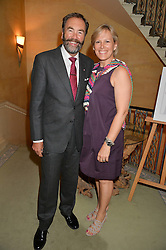 Bob Walton and Rosalind Milani Gallieni at The House of Britannia reception hosted by Lady Delves Broughton at 42 Berkeley Square, London on 26th June 2014.