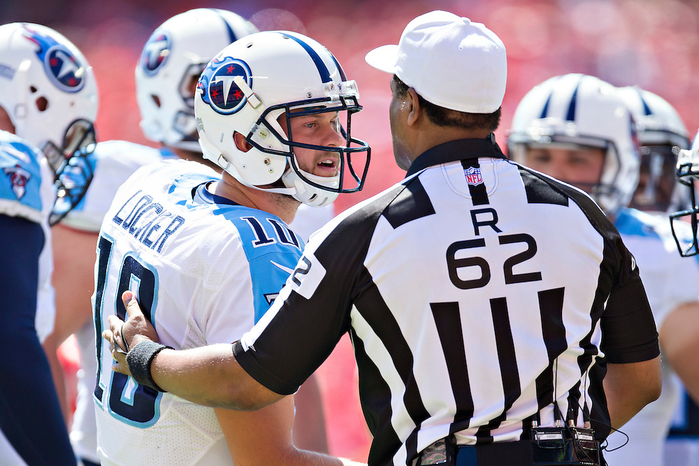 KANSAS CITY, MO - SEPTEMBER 7:  Jake Locker #10 of the Tennessee Titans talks with Referee Ron Torbert during a game against the Kansas City Chiefs at Arrowhead Stadium on September 7, 2014 in Kansas City, Missouri.  The Titans defeated the Chiefs 26-10.  (Photo by Wesley Hitt/Getty Images) *** Local Caption *** Jake Locker; Ron Torbert