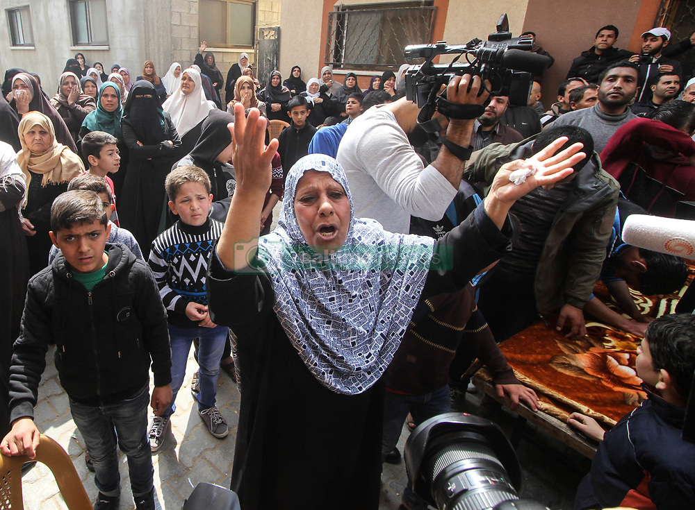 """March 23, 2019 - Gaza, Palestine, 23rd March 2019. A large crowd give their final farewell to 24 years-old Jihad Munir Haraa in the Shujaiya neighbourhood on the east of Gaza City. Jihad had died after being shot in the head with a live bullet by the Israeli forces during the Friday border protest in the central Gaza Strip on 22nd March. According to the Gaza Health Ministry at least 62 other Palestinians were shot and injured, while dozens of demonstrators had suffered from tear-gas inhalation on last Friday's Great March of Return rally as Israeli forces tried to suppress the protesters along the eastern borders of the besieged Gaza Strip. The Israeli military stated that troops had responded with """"riot dispersal means"""" and fired in accordance to standard operating procedures.  At least 257 Palestinians have been killed by Israeli fire in Gaza since weekly protests began on March 30th 2018 (Credit Image: © Ahmad Hasaballah/IMAGESLIVE via ZUMA Wire)"""