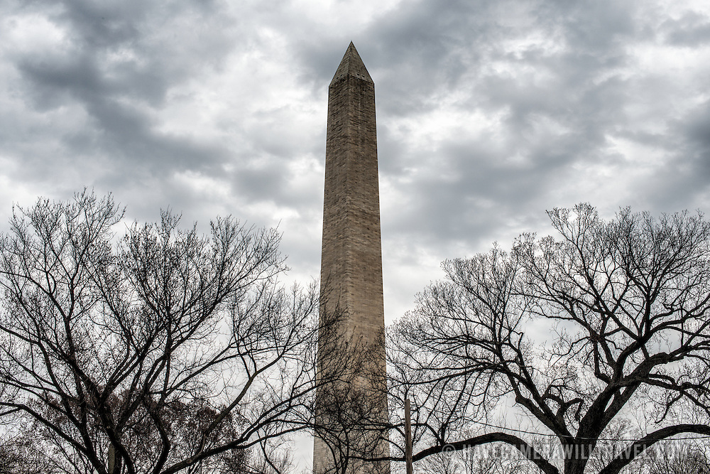 Wintry clouds over the Washington Monument on the National Mall. Built to honor George Washington, the country's first president, the 555-foot marble obelisk towers over Washington DC and stands in the center of the National Mall.