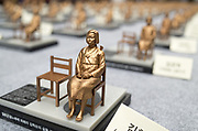 Miniatures of the Comfort Women Statue or the Peace Monument symbolizing Korean Comfort Women or sex slaves by Japanese military during the Second World War, are displayed at a plaza in Seoul, South Korea, Aug 14, 2017, during an event to mark the memorial day for the victims, which falls on August 14, 2017. Photo by Lee Jae-Won (SOUTH KOREA) www.leejaewonpix.com