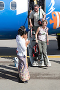 Southeast Asia, Thailand. A Thai welcome in Trat airfield to the passengers disembarking from a Bangkok Airways aeroplane