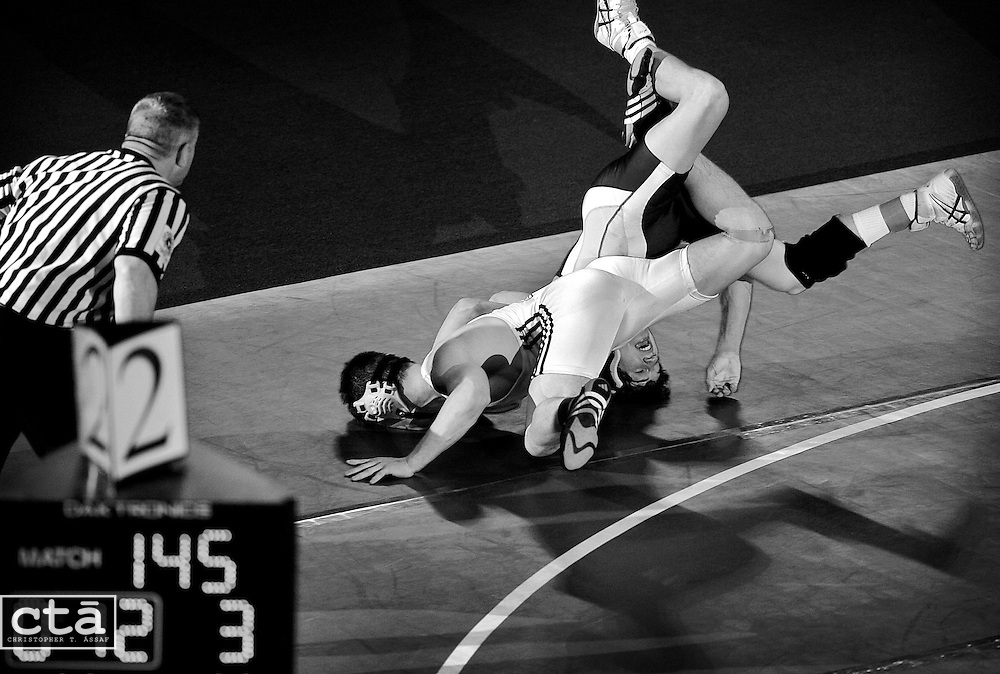 Hereford's Josh Asper (dark uniform) forces Matt Kahl of Harford Tech out of bounds during the first overtime of their 145-pound 1A-2A state championship match. Asper won 5-4 in the second overtime of their match.