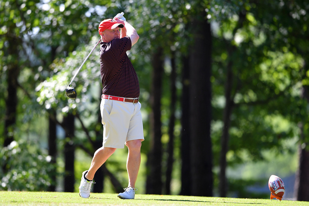 David Dukes tees off during the Chick-fil-A Peach Bowl Challenge at the Oconee Golf Course at Reynolds Plantation, Sunday, May 1, 2018, in Greensboro, Georgia. (Dale Zanine via Abell Images for Chick-fil-A Peach Bowl Challenge)
