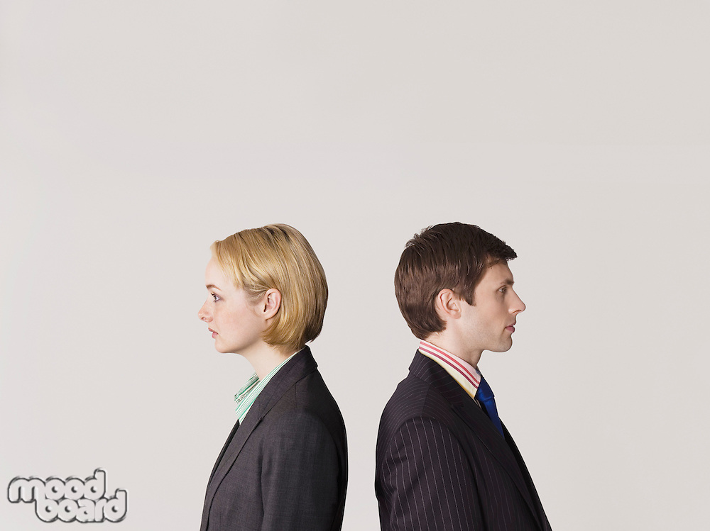 Business people standing back to back on white background